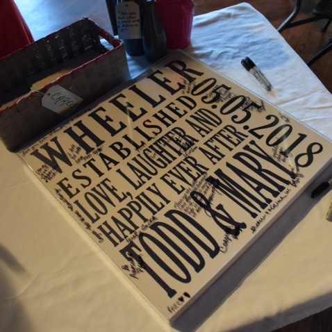 Guests were able to sign a large plaque that hangs in our living room